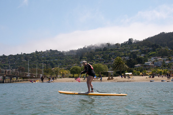 Karen on her first SUP board.  The beautiful Sausalito hills behind her.