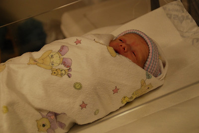 She was already fighting the swaddle and hat.  Thankfully under the baby warmer this wasn't a big deal!