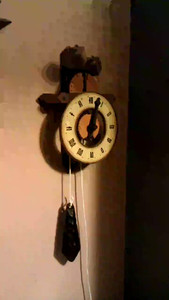My parents gave me this Buco verge and foliot clock a long time ago.  I used to have it in my room in their house.  Always found the sound of it very soothing.  Unfortunately the original weight cord wore out after a few years and I tried several replacements but they were all either too thin or too thick to fit correctly.  I finally found some replacement sash cord that works.  I would have preferred cotton over poly since the catch gear is plastic and the poly feels a little slick on there.  But it hasn't slipped on me yet in about 9 hours of testing.    Katie loves it.  Not as much as she loves the cuckoo in the clock next to it.  But she still loves it.  Now I just have to figure out where to hang it permanently.  This test location is too low and there isn't room for the weights.  And while I love the sound I think Amy is starting to find it annoying even though she keeps saying it's relaxing.  Most of the places I have vertical room to hang it are on brick/plaster walls and I hate trying to hang things on them.