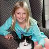 11-10.  Katelyn and Kiki took over Grandma's chair.