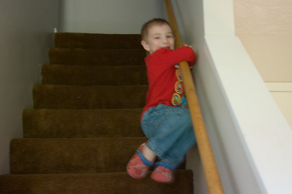 Jake finds a faster way to get down the steps.