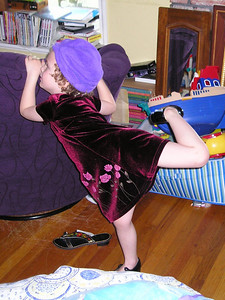 Demonstrating the new tap shoes and nifty purple hat.