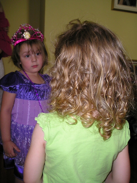 """Well, your hair is pretty nice, but I've got a tiara and a purple princess dress."""