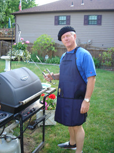 Dad manning (?) the grill with his Father's Day gift apron/grill set!