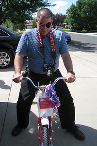 Celebrating Rachel's 8th Birthday in Fort Collins - John testing the new bicycle
