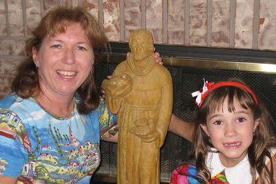 Celebrating Rachel's 8th Birthday in Fort Collins - St. Francis statue from Berta and Cheryl in memory of Tracy's Dad