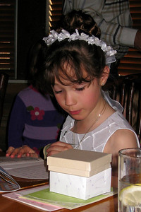 Family and Friends gathered to celebrate Rachel's First Communion at Mimi's Cafe - Rachel reading her card from Cheryl and Shorty Giacomazzi