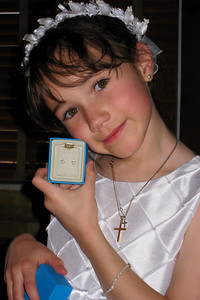 Family and Friends gathered to celebrate Rachel's First Communion at Mimi's Cafe - Rachel displaying her new Cross earrings