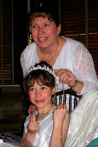 Family and Friends gathered to celebrate Rachel's First Communion at Mimi's Cafe - Rachel and her mother displaying her new rosary