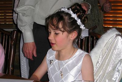 Family and Friends gathered to celebrate Rachel's First Communion at Mimi's Cafe
