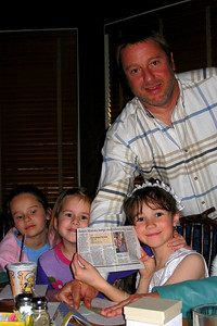 Family and Friends gathered to celebrate Rachel's First Communion at Mimi's Cafe - Rachel sharing her gift from Cheryl and Shorty Giacomazzi - a night at the Hannah Montana movie - with Tara and Tessa Whittaker and Andy