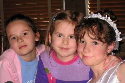 Family and Friends gathered to celebrate Rachel's First Communion at Mimi's Cafe - Tara, Tessa, and Rachel