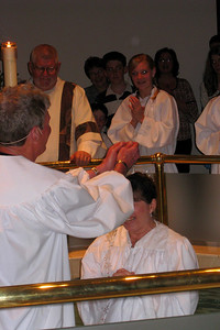 Rachel's First Communion and Tracy's RCIA - Easter Vigil Service at Natavity of Our Lord Catholic Church - Tracy being baptized