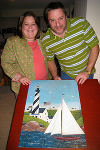 Christmas 2008 in CO -  - We decided to resurrect the family tradition of putting a puzzle together! Kathy and Andy showing the finished product.