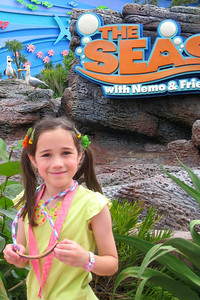 Rachel in front of the Nemo-themed ride. The Seas with Nemo & Friends is one of the largest facilities ever dedicated to humanity's relationship with the ocean. It was designed by Disney Imagineers, in cooperation with distinguished oceanographic experts and scientists. Once inside, guests can find the animated critter's real-life counterparts, including clownfish, blue tangs, sharks, and puffer fish. Thu - 5/28/09