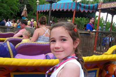 Adventureland - The Magic Carpets of Aladdin features 16 carpets that fly through the air in a fashion similar to those airborne elephants in Fantasyland. Rachel controlled the carpet's vertical movement from the front seat with Grandma. Kathy didn't know she had the ability to control the side-to-side movement! Grandma was unpleasantly surprised with a stream of liquid from an expectorating camel! Fri – 05/29/09