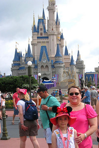 Rachel and Kathy are standing in front of the Cinderella Castle. Fri – 05/29/09