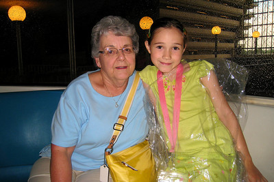 Rachel and Mary Clare Kane sitting in the front car with the monorail driver inside the Contemporary hotel as we headed back to Epcot after our rest and swim at the Polynesian. It was raining again! Thu - 5/28/09