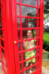 Our tour of the World Showcase took us to the United Kingdom; Rachel had to check out the telephone booth. Thu - 5/28/09