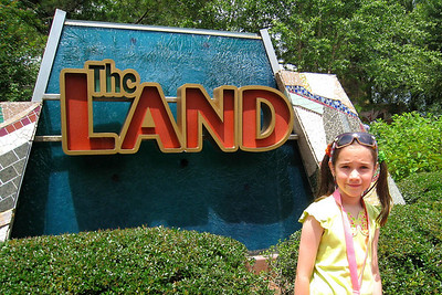 Rachel is posing in front of The Land which occupies six acres. This enormous skylighted pavilion examines the nature of one of everybody's favorite topics - food. It also gives guests a chance to soar above the clouds in a celebration of flight on the attraction Soarin'. We got a Fastpass for later in the afternoon. On this high-flying new attraction, you'll be suspended in a hang glider 45 feet in the air, above a giant IMAX projection dome, and treated to an aerial tour of some of the most awe-inspiring landscapes the state of California has to offer. With the wind in your hair and your legs dangling in the breeze, the multi-passenger hang glider feels so convincingly real that you may be tempted to pull up your feet for fear of tripping over a treetop as you dip down toward the group. During the rather peaceful journey, flyers glide toward the Upper Yosemite Falls of Yosemite Valley, past an active naval aircraft carrier in San Diego Bay, by San Francisco's Golden Gate Bridge, and then down over the vast deserts in Death Valley and the lush wine county of Napa Valley. Thu - 5/28/09