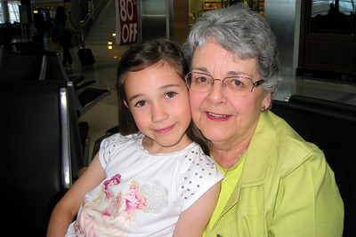 Grandmother and Granddaughter at DFW Airport - Mary Clare and Rachel traveled from Denver to DFW Airport to meet Kathy for their final leg to the Orlando airport. We stayed at the Holiday Inn Express after a van ride to the Holiday Inn Select and the realization we were at the wrong hotel! Wed - 5/27/09