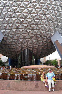 "Mary Clare and Rachel in front of Spaceship Earth, the many-faceted ""geosphere"" that has become the universal symbol of Epcot. A common misconception is that Spaceship Earth is a geodesic dome. It is a geosphere. A dome is only half a sphere, while Spaceship Earth is almost completely round. Affectionately known to many simply as ""the Ball"", Spaceship Earth is indeed a sight to behold. Thu - 5/28/09"