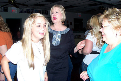 Let the Good Times Roll – 10/24/2009 - Celebrating October and November Birthdays - The girls are dancing - Caroline, Cheryl and Cindy - to 'We are Family'!