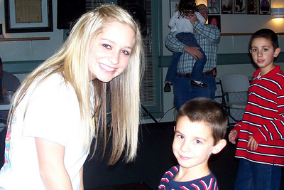 Let the Good Times Roll – 10/24/2009 - Celebrating October and November Birthdays - Caroline and Carson dancing; Cole is watching and Michael is holding Summer in the background