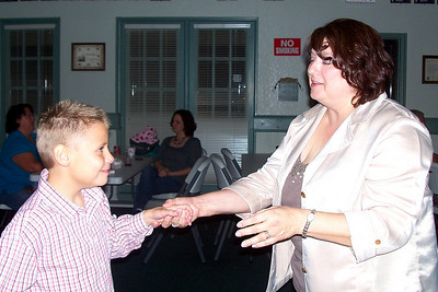 Let the Good Times Roll – 10/24/2009 - Celebrating October and November Birthdays - Mother and Son dancing