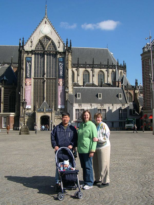 """Chris, Katie, Susan and Jonathan on the Dam (the main city square in Amsterdam), with the """"New"""" Church in the background."""