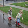 Puddle Marching <br /> Katie and Matthew went for a walk in the puddles after the rain.