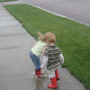 Stomping in a puddle <br /> Katie and Matthew went for a walk in the puddles after the rain.