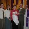Katie's baptism <br /> With sponsors Jody and Becky