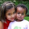 Playing with neighbor big sister Ariana. Photo courtesy Advani Photography