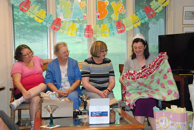 Jane Lutz, far left, made this baby blanket. Jane is the cousin of Kelly's mom. From left are Jane, Nancy Lutz (Rosanne's aunt) and Melinda Wulf (Kelly's aunt).