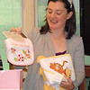 "Aunt Theresa's gift: A Pooh bath towel, a Pooh/Tigger bath towel, and a bib that says ""I love my aunt."""