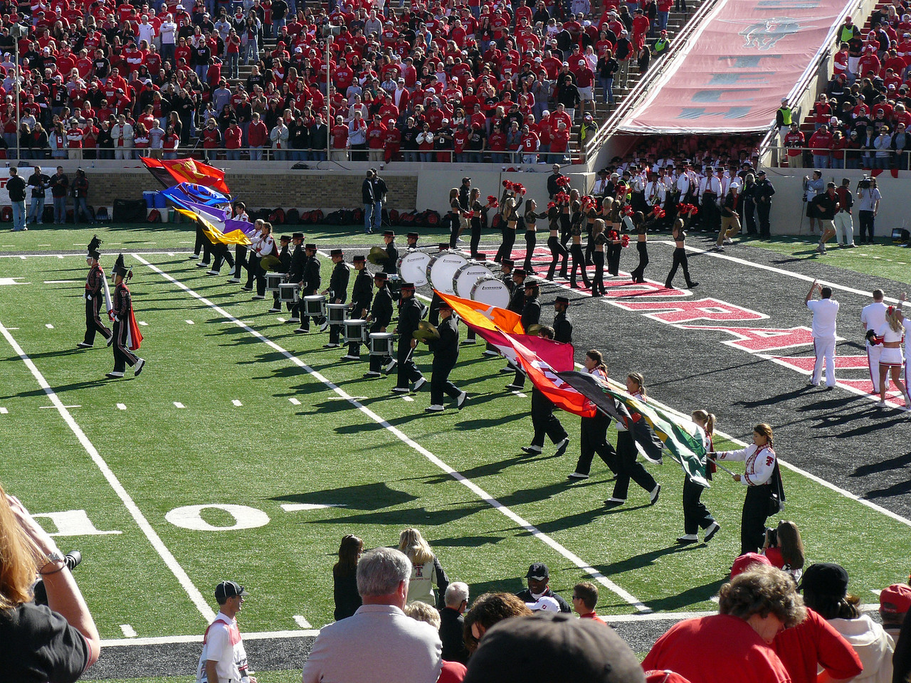 Band color guard entering the field