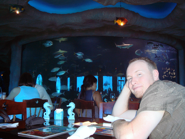 Inside Aquarium.  The view from our table.  The tank behind Brian is 50k gallons and has 3 species of shark.