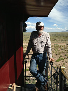 Ken on the Cumbres-Toltec narrow-guage steam train, approaching Antonito, Colorado.