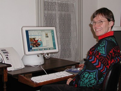 Ken took this photo of me (and my new Mac) in February 2003