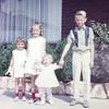 Heidi, Barbara, Jill & Doug. In front of Burton home. 1965