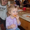 Claire enjoying the pizza.