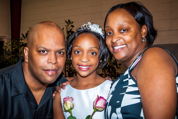 Mom and Dad pose proudly with their lovely Princess Kenya