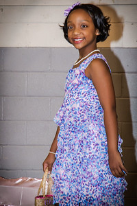 """Kenya beams a glamours smile during the """"Walk"""" event for the Cotillon"""