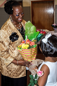 Princess Kenya presents flowers to her mentor Ms. Sparks