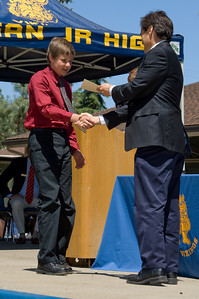 Getting his Egan Junior High diploma at graduation