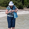 Jean beachcombing.<br /> The water is knee high for about 200 yards out and great for wading and exploring the flats.