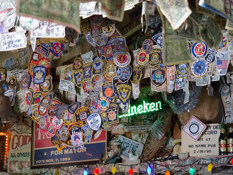 Collection of police and fire fighter badges.