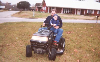 Jim and EJ on Lawn Tractor Christmas 2000 1446 14th Street Hempstead, Texas