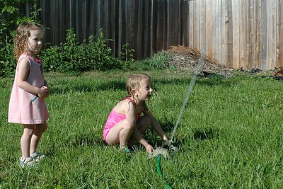 Mae and Mary setting up the sprinkler.